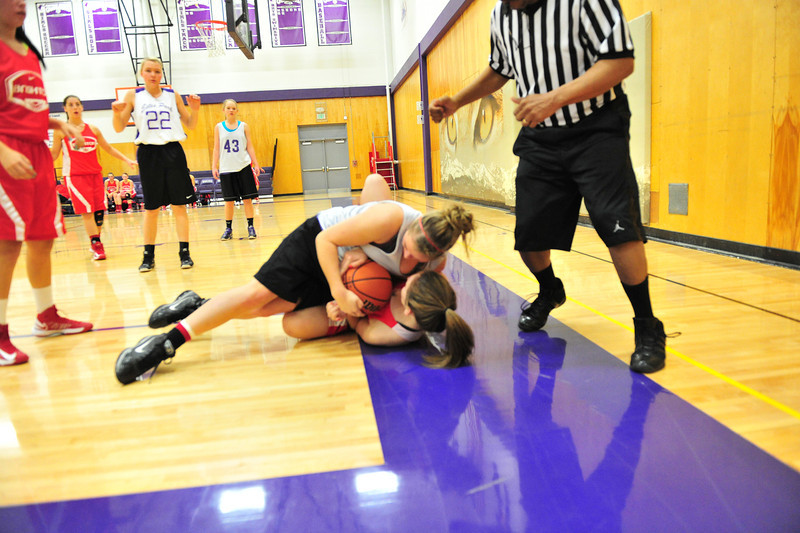 23EPLadycats on the floor.jpg Ladycats wrestle for the ball against a Brighton player on Saturday. Estes Park coach Steve Pistrui was pleased with the level of play, aggression and speed of his Ladycats, helping to compensate for Brighton's size advantage.