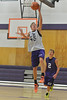 23EPBobcats Layup.jpg Bobcat sophomore Isaak Cirone goes for a lefthanded layup during Monday drills. The team has another scrimmage this weekend before beginning regular season play on December 1.