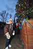 23EPLPht Ornamental Tree.jpg A little visitor stands next to one of the trees in Riverside Plaza on Saturday. The tree was filled with ornaments made by visitors to the event.