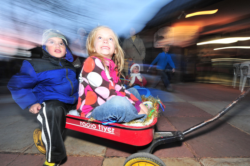 23EPLPht Wagon Rides.jpg Children enjoy a spin around Riverside Plaza in decorated red wagons on Saturday. The celebration was geared toward the whole family.