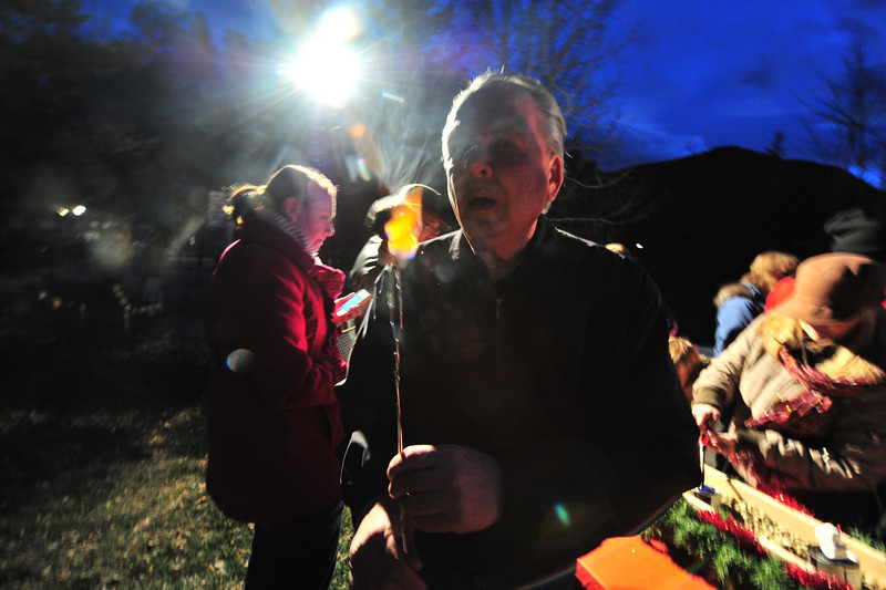 23EPLPht Flaming S'Mores.jpg Bob Wozny of Denver takes a flaming marshmallow for his enjoyment on Saturday. While the celebration did not have the fire pit of Bond Park, visitors found alternate ways to prepare s'mores.