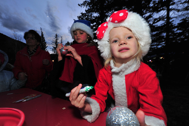 23EPLPht Custom Bulb.jpg Charlotte Nagl of Estes Park puts her own touch on an ornament on Saturday. Visitors were encouraged to be creative at the pre-lighting festivities.