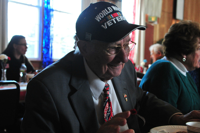 Bill King enjoys breakfast and conversation at the American Legion Veterans' Day Breakfast on Sunday. King is one of several World War Two veterans living in Estes Park.