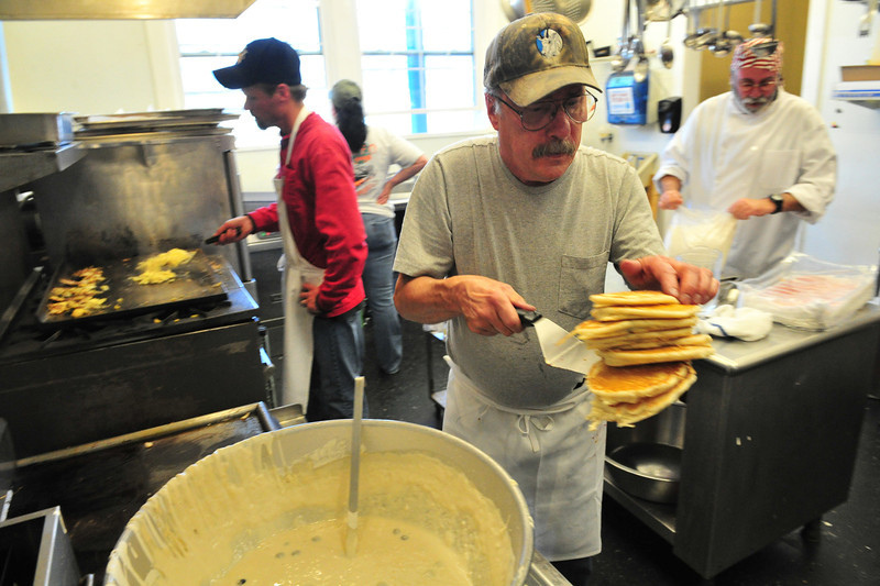 The kitchen staff works hard and fast for the Veterans' Day Breakfast on Sunday. This year the American Legion kitchen put blueberries in the pancakes.
