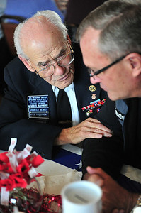 Merchant Marine Norris Nahman talks to an aquantence at the American Legion on Sunday. During World War II, the Merchant Marines were also pressed into service to protect the US coast.