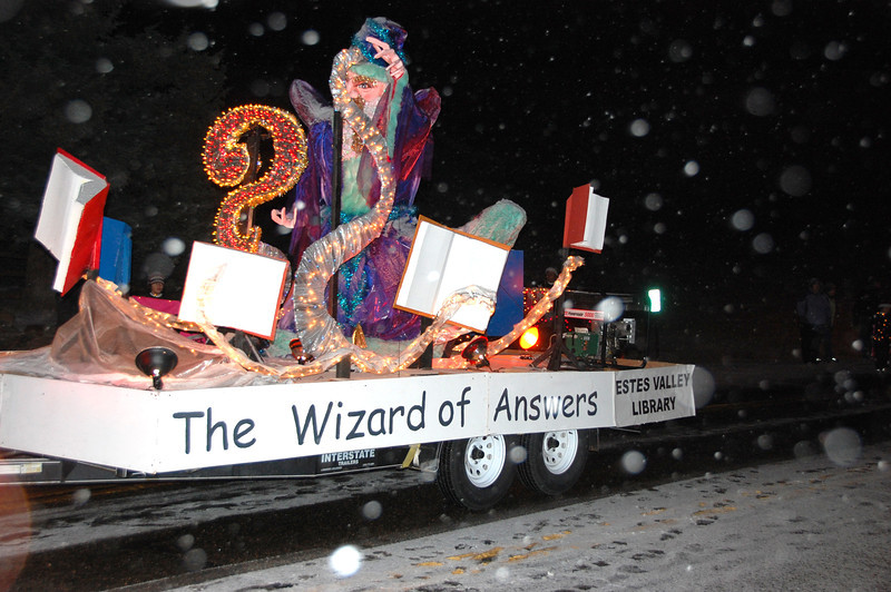 """30ep glow wizard of answers.jpg The Estes Valley LIbrary float in the 2011 Catch the Glow parade carried the """"Wizard of Answers."""""""