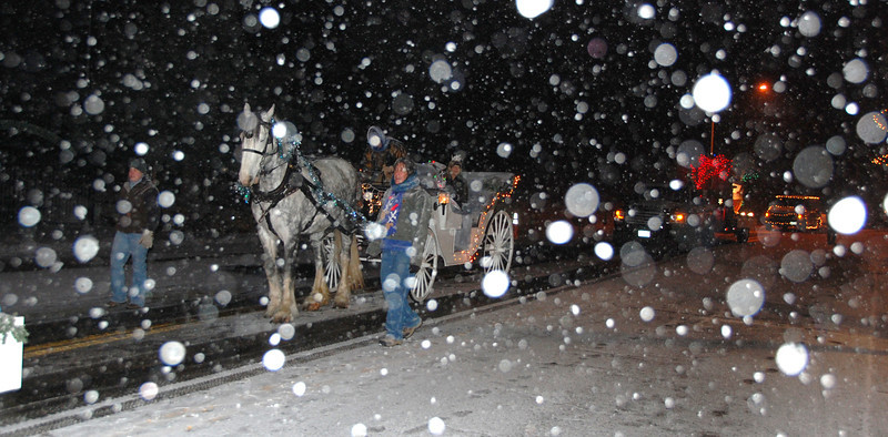 30ep catch glow horse and carriage.jpg Snow flurries highlighted much of the 2011 Catch the Glow parade through downtown Estes Park.