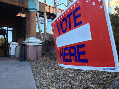 """Light breezes blow a """"Vote"""" sign around at the Rocky Mountain Park Inn voting center on Tuesday. A nicer day for voting can't be had as clear skies and warm temperatures are expected. Highs should reach into the mid 60s."""