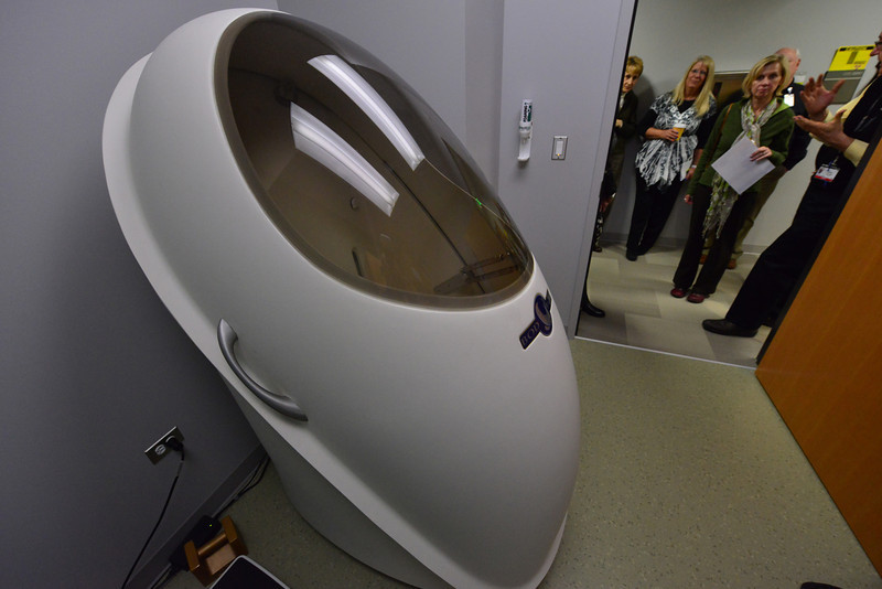 Estes Park visitors inspect a Bod Pod, a device that uses air displacement to determine body compesition,  at the Anschutz Health and Wellness Center in Aurora on Tuesday. Hospital representatives and fitness anthusiasts got a tour of the state-of-the-art facility, the likes of which they wish to bring to Estes Park.