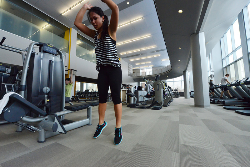 Samantha Nino, wellness center member and first-year medical student, performs an exercise on the spacious floor of the facility. The center offers plenty of opportunities for active people to engage in fitness.