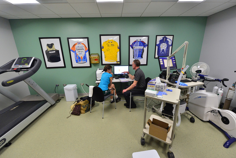 Trisha Schmit watches as Kevin Nichol explains the data from her fitness test under a familliar yellow jersey of the Tour de France, signed by winner Alberto Contador. The proposed wellness center in Estes Park would offer such testing for the elite athlete to the weekend warrior.