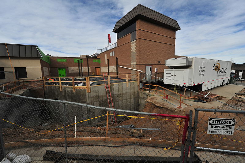 Work continues on the space that will house the Estes Park Medical Center's MRI machine, while the mobile version sits on its pad next to the construction. The construction will last well into winter.