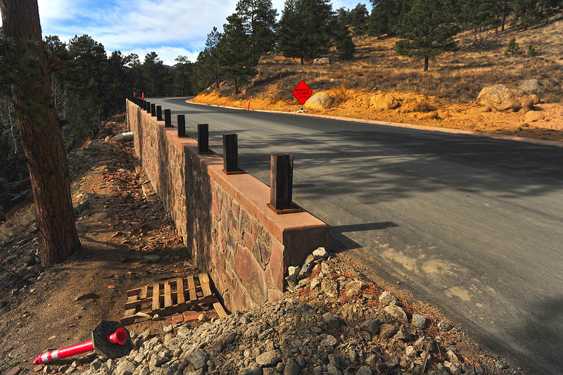 Metal posts await a guard rail along the new stretch of Bear Lake Road on Monday. The project is the biggest and taking the longest of all of the construction projects in the erea, and will likely serve the most people.