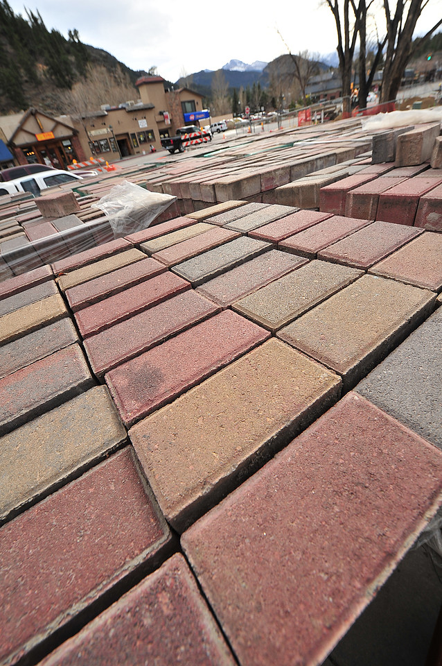 Neat piles of bricks stand near the town hall on Monday. The bricks have been layed, pulled up and replaced several times in an attempt to get the paving just right.