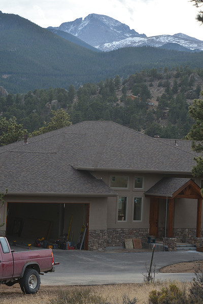 A new house exterior looks complete just west of South St. Vrain on Monday. Some new home construction outside of the Woodland Heights area is proceeding in the Estes Park area.