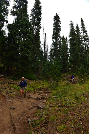 Walt Hester | Trail-Gazette<br /> Gloria Black, left, and Joyce Klein hike the Chapin Pass Trail on Wednesday. The clouds andrain were no deterrent for many hikers in Rocky Mountain National Park.