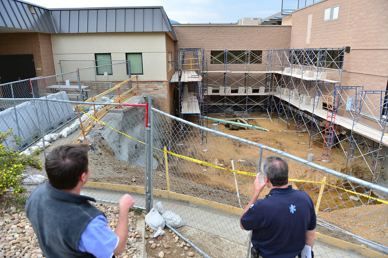 Walt Hester | Trail-Gazette<br /> Emergency room employees take a peek at the construction zone at the hospital on Monday. The space is intended for an MRI machine.