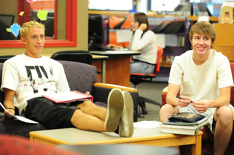 Walt Hester   Trail-Gazette<br /> Andrew Cirone, 18, and Jason Prince, 16, seem to be enjoying their first day of the new school year at Estes Park High School on Monday. The elementary school begins classes on Wednesday.