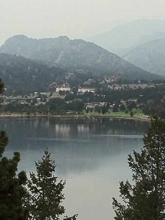 The Stanley Hotel reflects off of Lake Estes on Monday. Chilly an overcast to start the day. We may see some clearing midday. Expect a high near 74.
