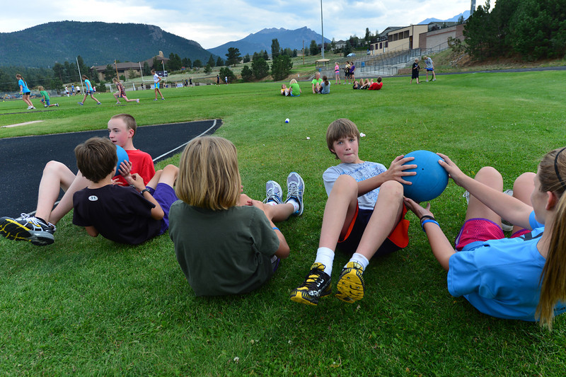Walt Hester | Trail-Gazette<br /> Middle school runners use medicine balls to work their core muscles on Wednesday. Many endurance sports are embracing resistence exercises.