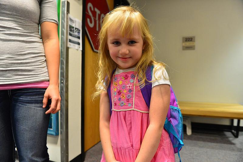 Walt Hester | Trail-Gazette<br /> Lauren Allen, 5, gives a shy smile before heading to her first day of kindergarten on Wednesday. Lauren's mother graduated from Estes Park High School.