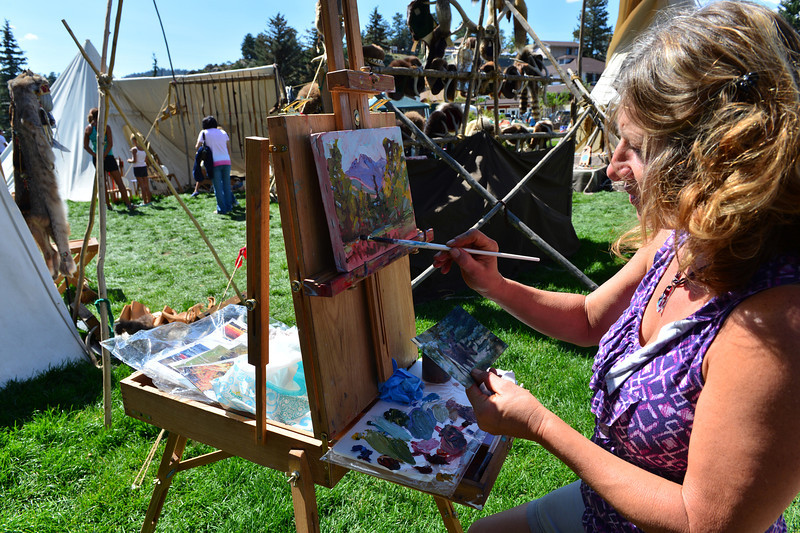 Walt Hester | Trail-Gazette<br /> Dawn Normali paints the scene at the Heritage Festival in Bond Park on Sunday. The two-day festival celebrates the heritage of the American West and the Rocky Mountains.