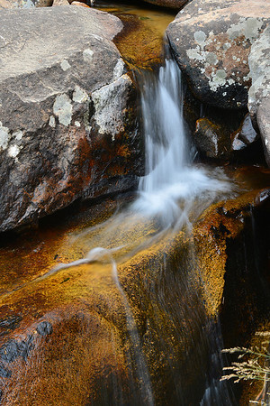Walt Hester | Trail-Gazette<br /> Water streams toward Chasm Falls on Wednesday. The trail to the falls remains closed while repairs on reconstruction comntinue.
