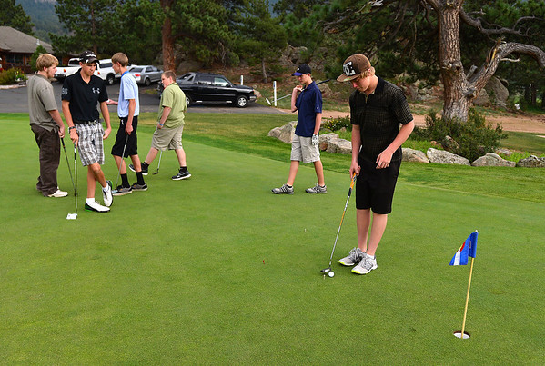 Walt Hester | Trail-Gazette<br /> Younger players line up to putt on Monday. The Estes Park High School boys' golf team has been busy, playing four tournaments last week.