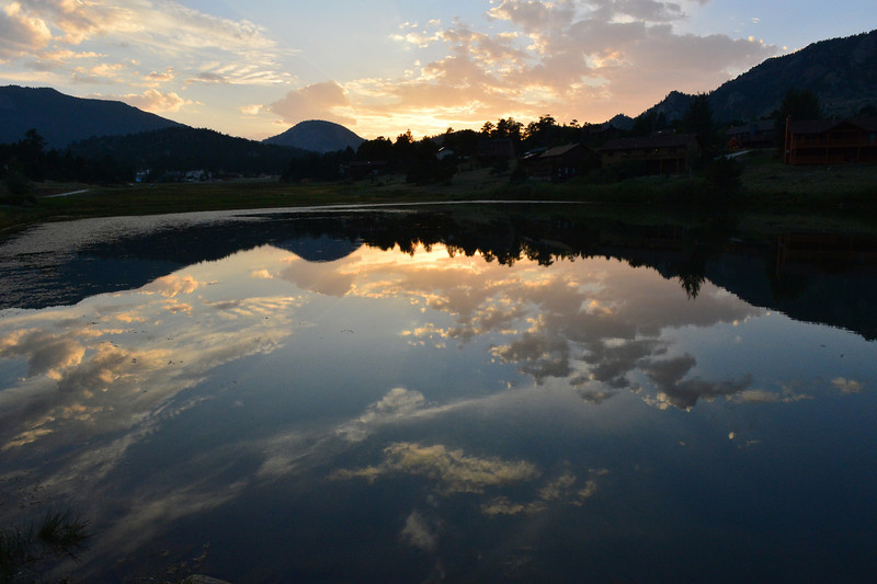 Walt Hester | Trail-Gazette<br /> Sunset reflect off of one of the Scott Ponds on Tuesday night. Skies may clear and tempertures rise for the coming weekend.