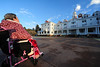 A visitor admires the Stanley Hotel in Friday morning's chill. Estes Park saw it's first measurable snowfall of the season on Friday.