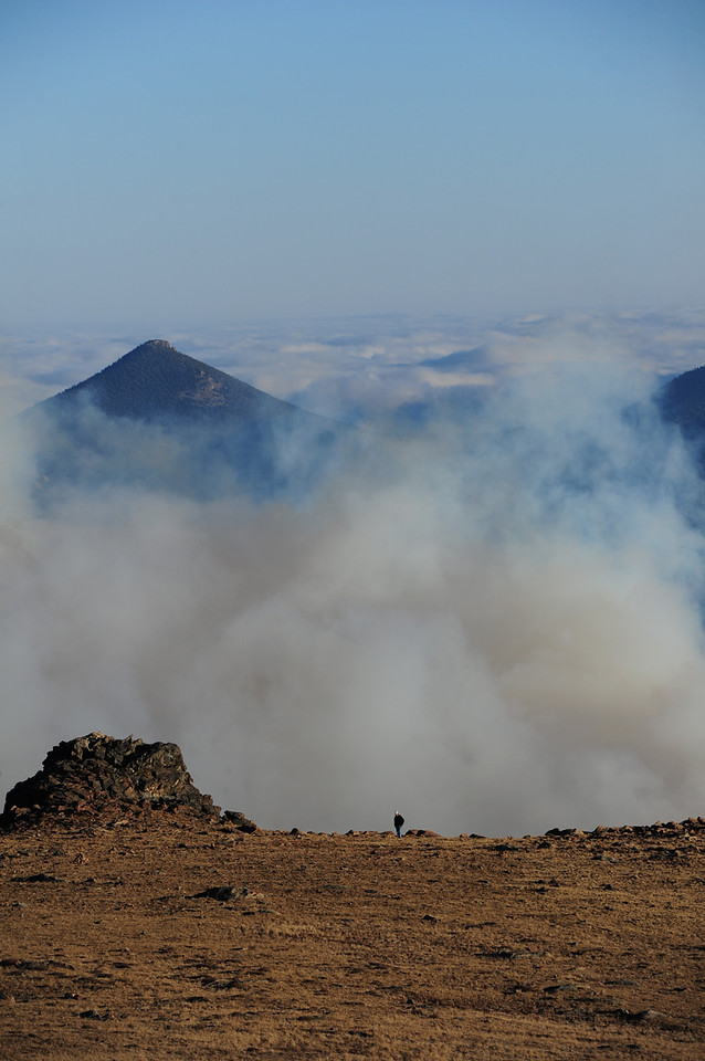 A hiker escapes the smoke of the wildfire by climb up the Ute Trail on Tuesday. The fire caused plenty of closures and changes in plans for visitors to the national park on Tuesday.