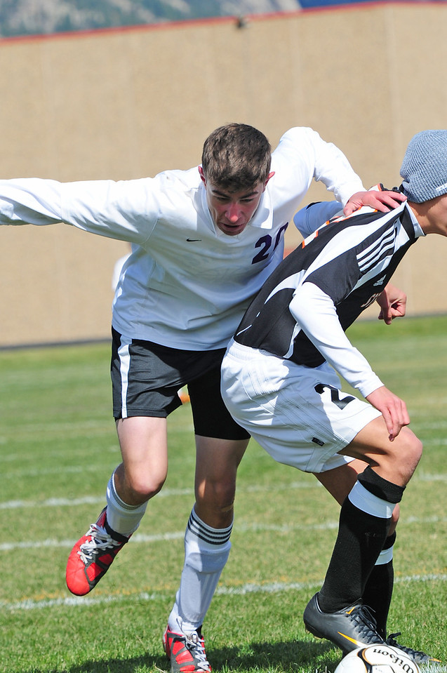 Jonathon Treat pushes through the Sterling defense on Saturday. The Estes Park forward has four goals and four assists on the season.
