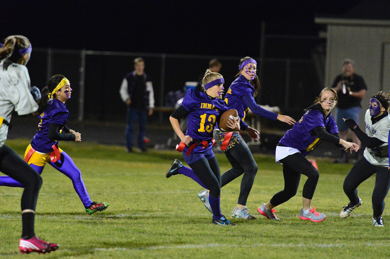 Karin Kingswood breaks into the open during last weeks Powder Puff game. Kingswood scored the Seniors' TD, but the PAT, scored by Rachel Hughes, was the difference as the Seniors beat the Juniors 8-6.