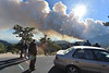Visitors stop at 3M curve to watch the column of smoke rise and drift toward Estes Park on Tuesday. The fire closed several roads, forcing visitors to different vantage points to try to view the fire.