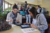 Seniors Brianne Barlow, 18, and Annette Cenac, 17, set up their new school-issued iPads at the school on Monday. The school owns the devices, but allows students to load personal content on to the devices in order to promote personal responsibility by the students.