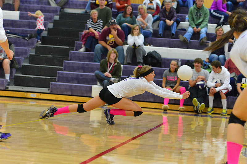 Karin Kingswood stretches to dig a hit against Brush last week. Kingswood and her fellow seniors will need to step up to pull the Ladycats out of their five-game tailspin.