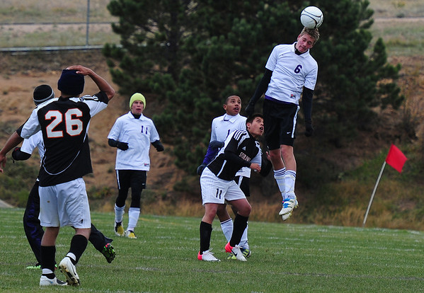 Isaac Cirone takes to the air to redirect a ball against Sterling on Saturday. The close game came out a 2-1 win for the Bobcats.