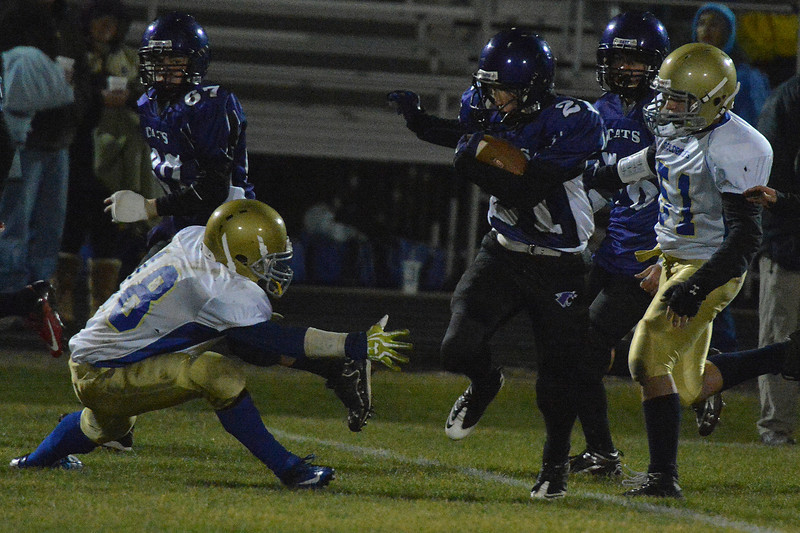Keith Trahan dodges a tackler after an interception against Clear Creek on Friday. Trahan ran the catch back 80 yards for a touchdown.
