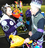 Erin Barker and Nate Dewitt congratulate each other after being crowned Homecoming king  and queen at the football game on Friday.