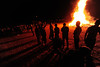 The bonfire reaches into the chilled air during Thursday's annual event. Firefiters stood by to keep it all safe.