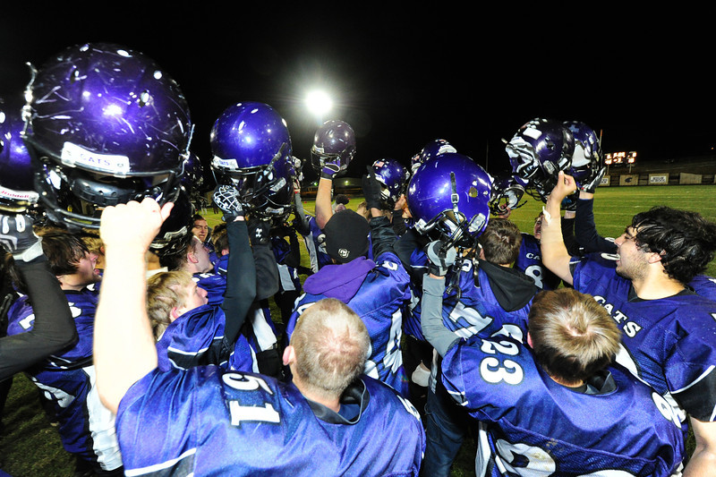 The Estes Park Bobcats celebrate their 28-20 Homecoming victory over Clear Creek on Friday night. The game not only took the team's record back to even, it was also the 'Cats' first homecoming win in many seasons.