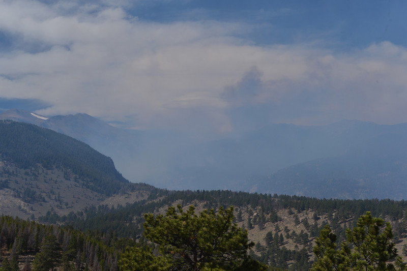 Smoke continues to billow out of Windy Gulch on Wednesday. The high winds did firefighters no favors, but disburst much of the dramatic smoke column seen on Tuesday.