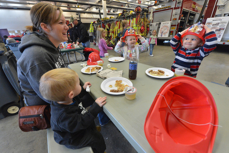 Levi Hicks, 1, mom, Tera, Jenika,5, and Myah, 3, enjoy breakfast at the firehouse on Saturday morning. Breakfast and fun were all at hand at the Dannels Fire Station as the Estes Park Volunteer Fire District hosted their annual pancake breakfast and openhouse.