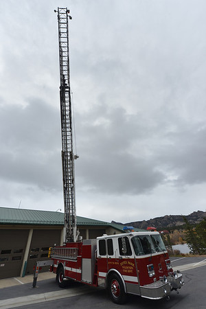 The fire department's big ladder truck goes largely ignored in the Saturday morning cold and wind. The Estes Park Volunteer Fire Department put on an openhouse inside where children could explore other equipment in comfort.