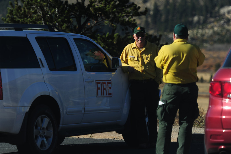 Wildland firefighters take time to photograph themselves with the national park's scenery on Sunday. The Fern Lake Fire required firefighters from far and wide came to quell the more than 700-acre fire.