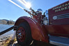 A vintage fire truck pumps water out, then sprays it back into Lake Estes on Wednesday. The truck is one of many that Doug Klink has restored to working order.