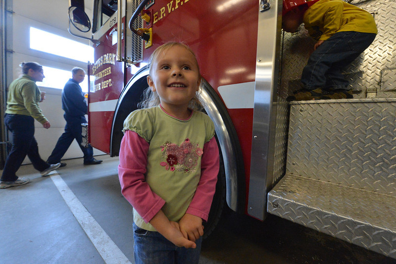A little visitor is all smiles at the Estes Park Volunteer Fire District's open house on Saturday. There is something about fire trucks that brings out the kid in everyone and the smile out of every kid.