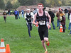 Russ Hall pounds through the closing meters of the Patriot League Championship Meet on October 6. Hall, a solid support performer, will need a great meet to propel the Estes Park boys to a regional championship.