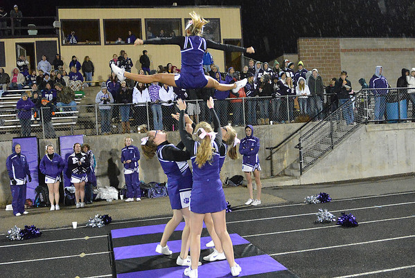 Cheerleaders perform for the home crowd as rain falls. While not as cold as the week before, the rain posed a challenge for the cheerleaders as the flip and fly.