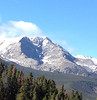 A whisp of a cloud rises over the summit of Ypsilon Tuesday afternoon in Rocky Mountain National Park.